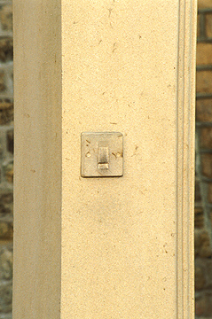 'Passing Through' - light switch carved in free-standing door